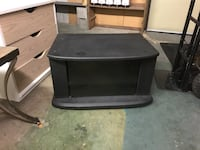 "Tv stand with shelves and smoked glass door approx 27.5"" wide 19"" deep and 16"" high Surrey, V3V 7L9"