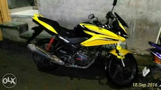 black and yellow Honda sport bike