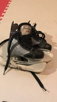 black-and-gray Bauer ice hockey skates Mississauga, L4T 2P7