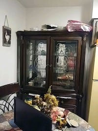 Brown wood frame glass display cabinet Albuquerque, 87110