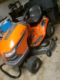 Riding lawn mower with catcher