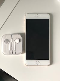 silver iPhone 6 with EarPods and charger Toronto, M8V 3C2