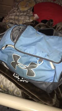 blue and black Nike duffel bag 1409 mi