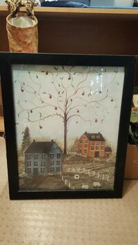 black framed painting of two houses