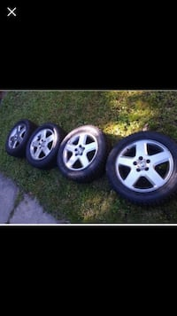 four gray 5-spoke car wheels with tires 274 mi