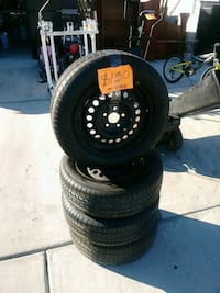 black 5-spoke car wheel with tire set Las Vegas, 89104