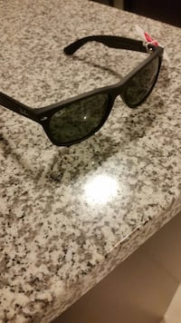 black framed Ray-Ban wayfarer sunglasses Toronto, M5V 1C3