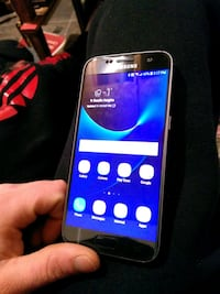 silver Samsung Galaxy 7 Android smartphone 3147 km