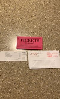 2 tickets for The Hit Men