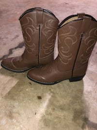 pair of brown leather cowboy boots Huntsville, 35801