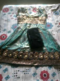 women's gold and teal sari dress