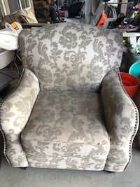 Sturdy chair with decorative rivets. Needs cleaning. Less than 1 year old   Gustine, 95322