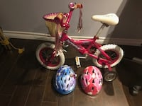 Toddler girls bike with two helmets.   RICHMONDHILL