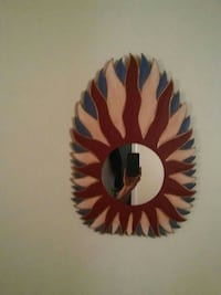 oval red, brown, and black wood-framed mirror Frederick, 21701
