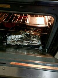 black and gray gas range oven Mississauga, L5W 1R7