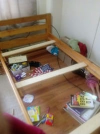 brown wooden bunk bed frame Hagerstown, 21740