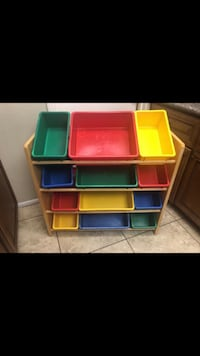 Red, blue, and green toy organizer 1954 mi