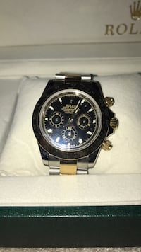 Round black chronograph watch with silver link bracelet Mississauga, L5R 3Y7
