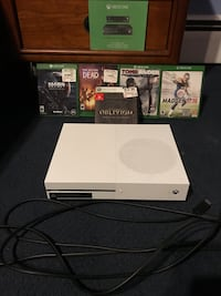 black Xbox One console with game cases Milford, 06460