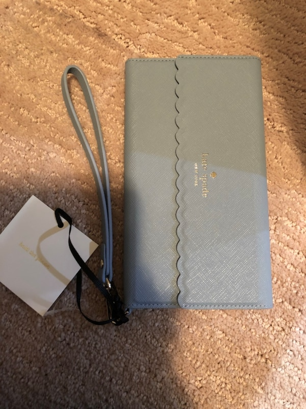 Brand new iphone plus cover from Kate Spade c9f184f7-70d6-41cc-9068-226369a1c018