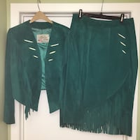 Emerald green Lariat leather jacket & matching skirt.