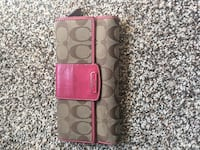 brown and pink legacy Coach monogram long wallet