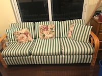 Green and white striped fabric sofa