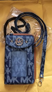 Michael kors across the shoulder phone case and wallet.   ****special. $40*** Odessa, 79764