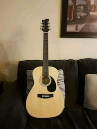 brown and beige  acoustic guitar 792 km