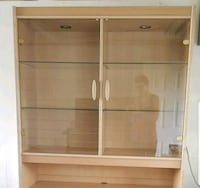 brown wooden cabinet with glass shells Coquitlam, V3J 6N9
