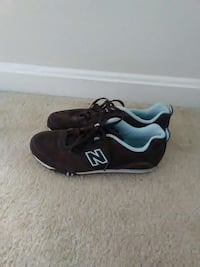 pair of black and white new balance low top sneakers Rockville, 20850