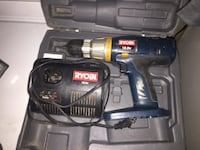 Blue ryobi cordless hand drill with black battery charger kit