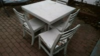 rectangular white wooden table with four chairs Toronto, M3L 1T7