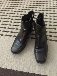 pair of black leather side zip booties Moncton, E1C 6P4