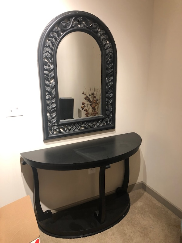 Black wooden framed wall mirror and table