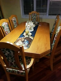rectangular brown wooden table with six chairs din 759 km