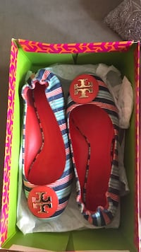 Pair of red-and-blue Tory Burch ballet shoes New York, 10022
