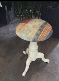 "Cast iron stool with adjustable height. Versatile stool. Uses: piano practice, ironing, doing homework, or crafts. Very stable that's newly upholstered & painted. Locks in at 18"", or raise to 24"""