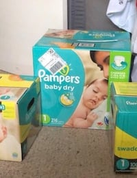 two Pampers Swaddlers disposable diaper boxes