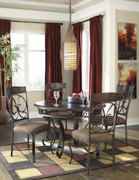 Glambrey Round Dining Room Table & 4 UPH Side Chairs