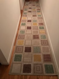 Beige, brown and green runner rug