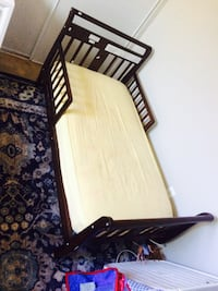 Brown wooden bed frame and whith  mettress