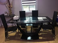 Rectangular glass top table with four chairs dining set