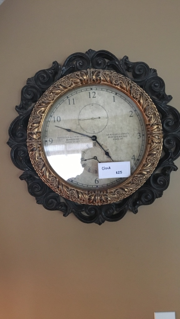 round black and brown analog wall clock