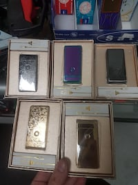 five assorted color powerbanks with boxes Montreal, H2E 2H8