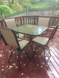 rectangular glass top table with four chairs patio set Fairfax, 22032