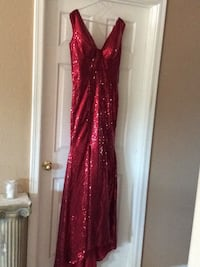 Beautiful shiny red party dress never used with tags. Phoenix, 85041