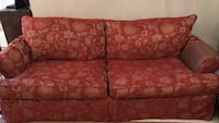 Red patterned sofa and loveseat