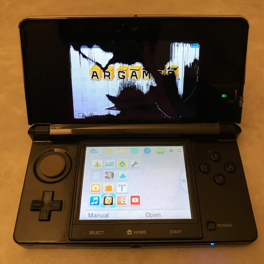 Black Nintendo 3ds system handheld console for parts video games