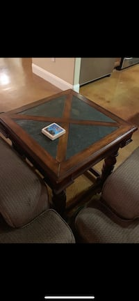 brown wooden framed glass top coffee table Turlock, 95382